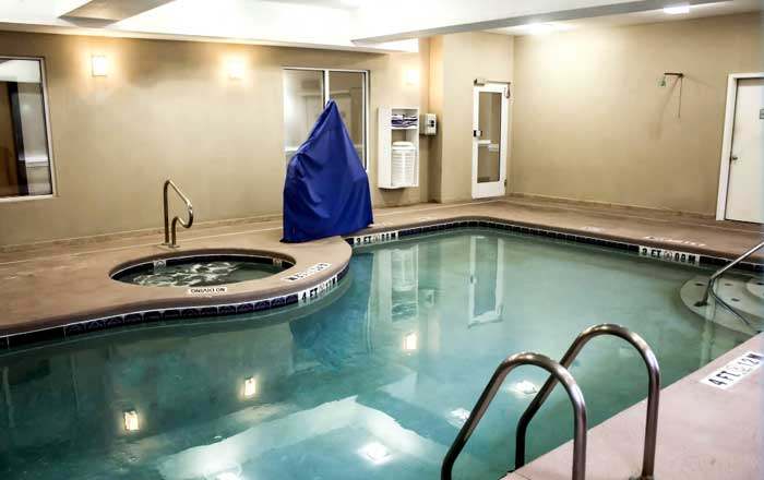 Indoor Pool Spa Hotels Motels Amenities Newly Remodeled Free WiFi Free Continental Breakfast Comfort Inn Suites Jekyll Island Brunswick GA Reasonable Affordable Rates Amenities Hotels Motels Lodging Accomodations Great Amenities Brunswick Georgia