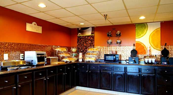 Free Hot Continental Breakfast Business Center Meeting Room Business Travelers Family Suites Kitchenettes Quality Inn and Suites Durham North Carolina by Duke and VA Hospitals