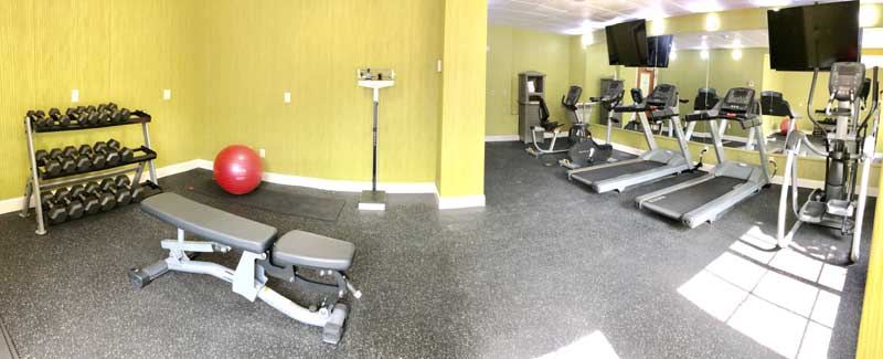 Fitness Room Hotels Motels Amenities Newly Remodeled Free WiFi Free Continental Breakfast Holiday Inn Express & Suites Disneyworld Orlando Kissimmee FL Reasonable Affordable Rates Amenities Hotels Motels Lodging Accomodations Great Amenities Kissimmee Flo