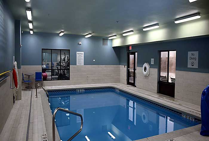 Indoor Heated Pool and Spa Hotels Motels Amenities Newly Remodeled Free WiFi Free Continental Breakfast Holiday Inn Express and Suites Wichita Airport Mcpherson KS Reasonable Affordable Rates Amenities Hotels Motels Lodging Accomodations Great Amenities M