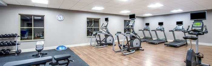 Fitness Room Hotels Motels Amenities Newly Remodeled Free WiFi Free Continental Breakfast Holiday Inn Express & Suites Kansas City West Shawnee KS Reasonable Affordable Rates Amenities Hotels Motels Lodging Accomodations Great Amenities Shawnee Kansas
