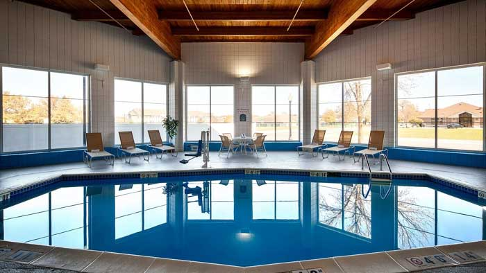 Indoor Heated Pool Hotels Motels Amenities Newly Remodeled Free WiFi Free Continental Breakfast Holiday Manor Speedway Newton IA Reasonable Affordable Rates Amenities Hotels Motels Lodging Accomodations Great Amenities Newton Iowa