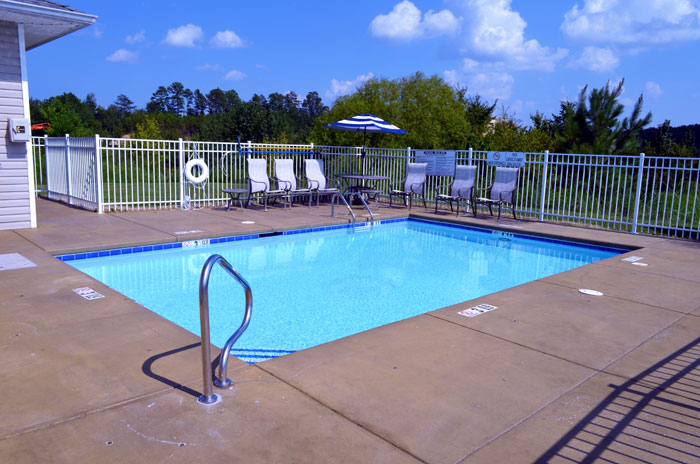 Seasonal Outdoor Pool Budget Affordable Lodging Motels Hotels Clean Comfortable Flat Screen TVs