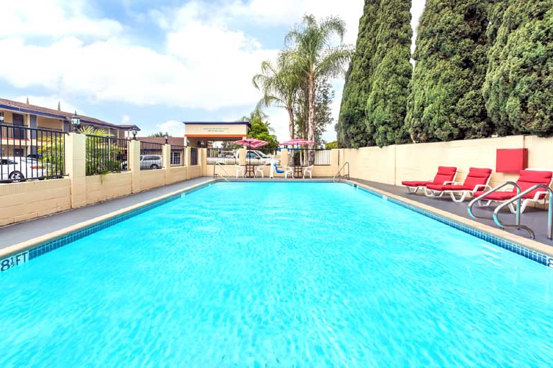 Seasonal Outdoor Pool Hotels Motels Amenities Newly Remodeled Free WiFi Free Continental Breakfast Howard Johnson Inn and Suites Disneyland Orange CA * Reasonable Affordable Rates Amenities Hotels Motels Lodging Accomodations Great Amenities Orange Califo