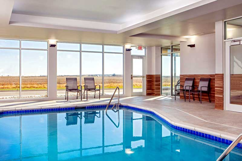 Indoor Pool Hotels Motels Amenities Newly Remodeled Free WiFi Free Continental Breakfast Fairfield Inn & Suites McPherson KS Reasonable Affordable Rates Amenities Hotels Motels Lodging Accomodations Great Amenities McPherson Kansas