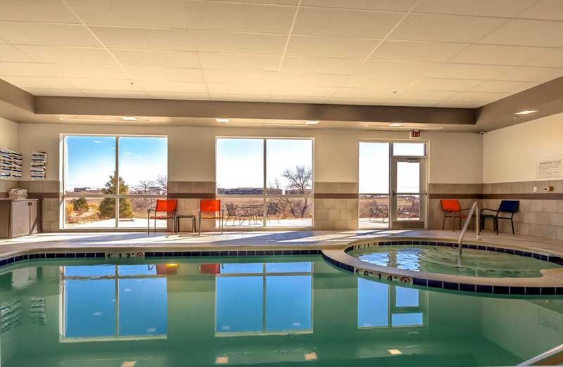 Indoor Heated Pool and Spa Hotels Motels Amenities Newly Remodeled Free WiFi Free Continental Breakfast Hawthorn Suites Loveland Johnstown CO Reasonable Affordable Rates Amenities Hotels Motels Lodging Accomodations Great Amenities Johnstown Colorado